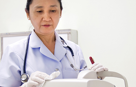 Nurse Cleaning Hospital Equipment